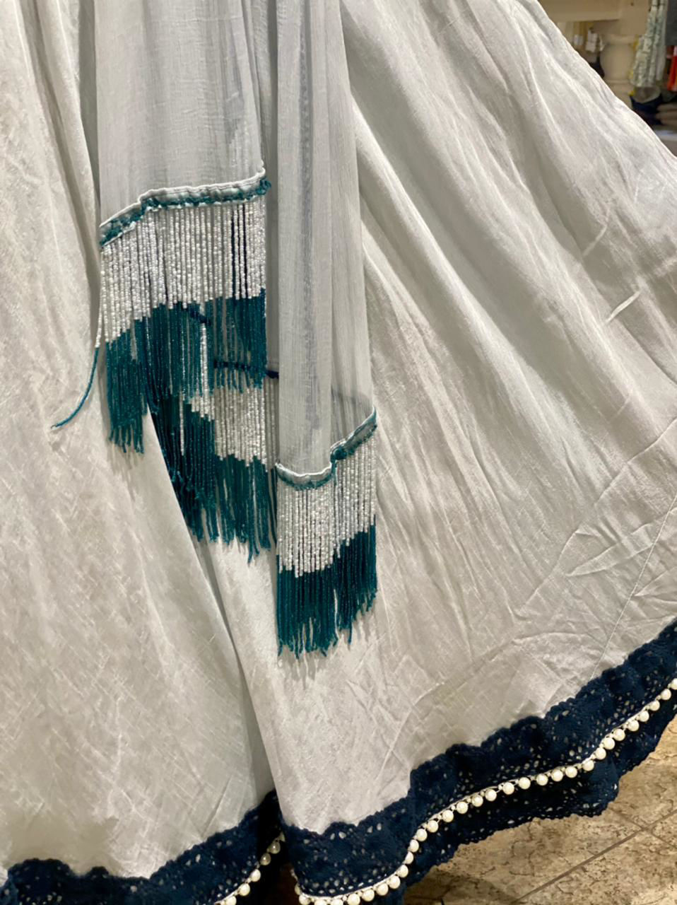 Picture of Short Blouse Cum Top With Thread Work With Flailed Skirt With Chiffon Dupatta