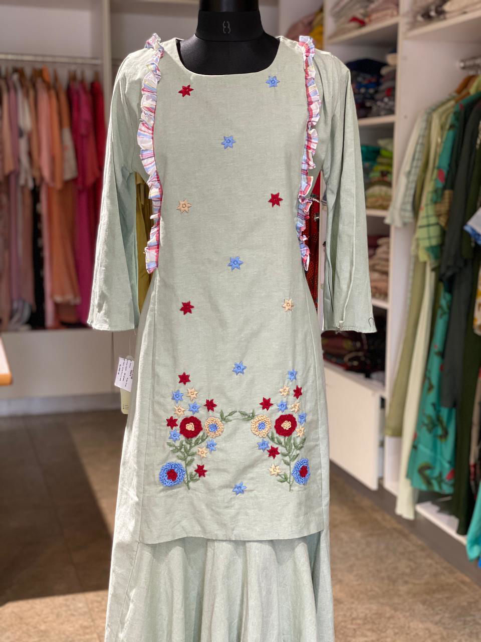 Picture of Long one piece dress style tunic with embroidery...checks frill for styling