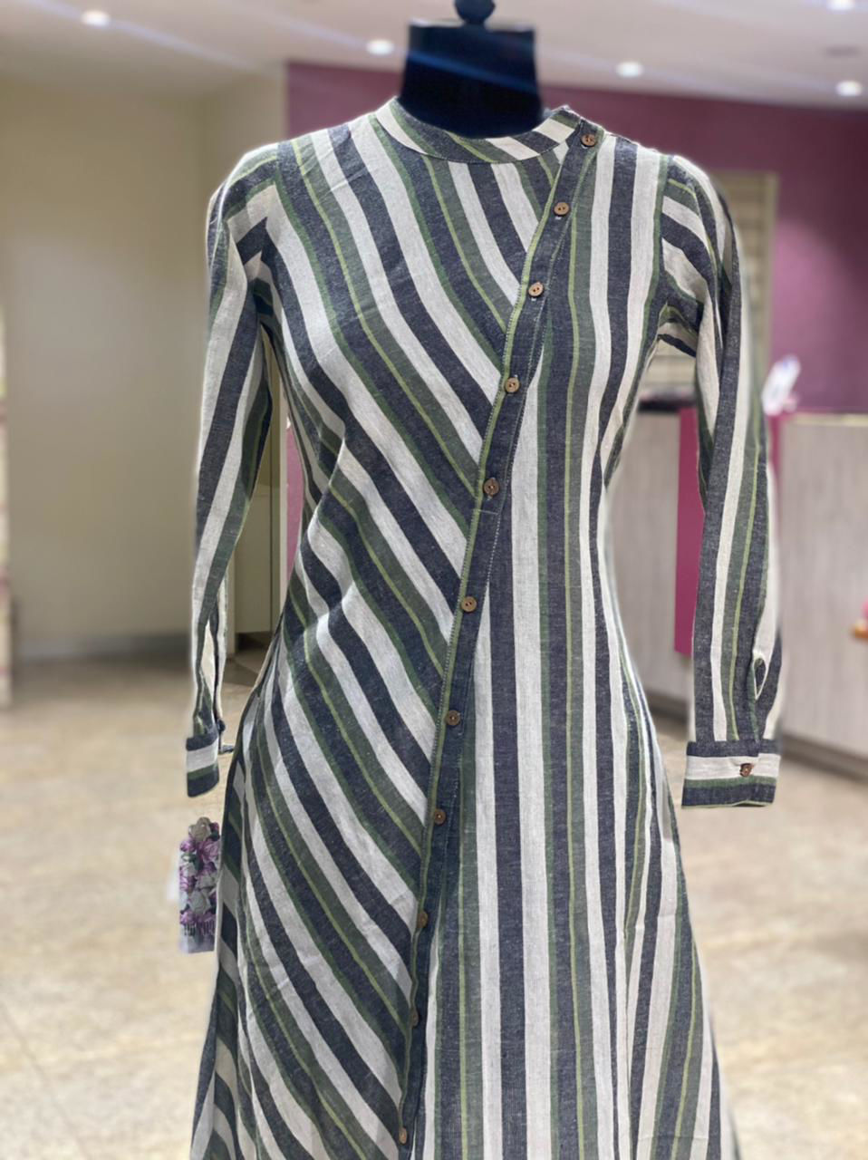 Picture of A Smart symmetrical cut tunic with pockets in stripes pattern
