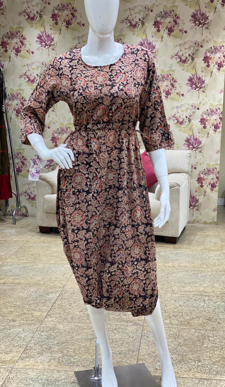 Picture of Kalamkari printed stylish jumpsuit with waist tie knots and harem style at the bottom with back zip