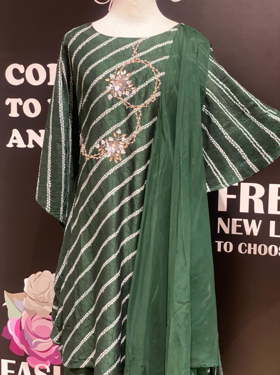 Picture of Original shibori in leheriya style with one side kaftan style and one bell sleeves with work.