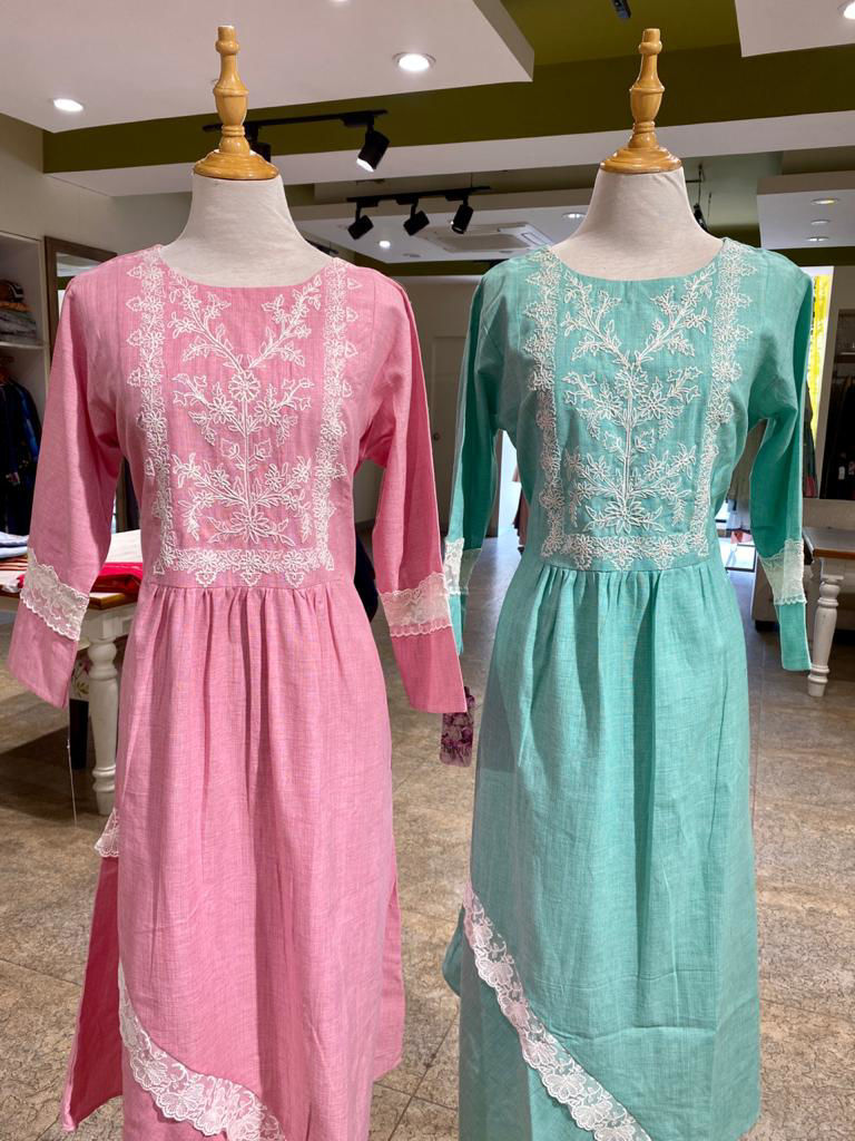 Picture of Smart linen based tunic with A symmetrical cut and yolk work and crocia lace work with same matching mask