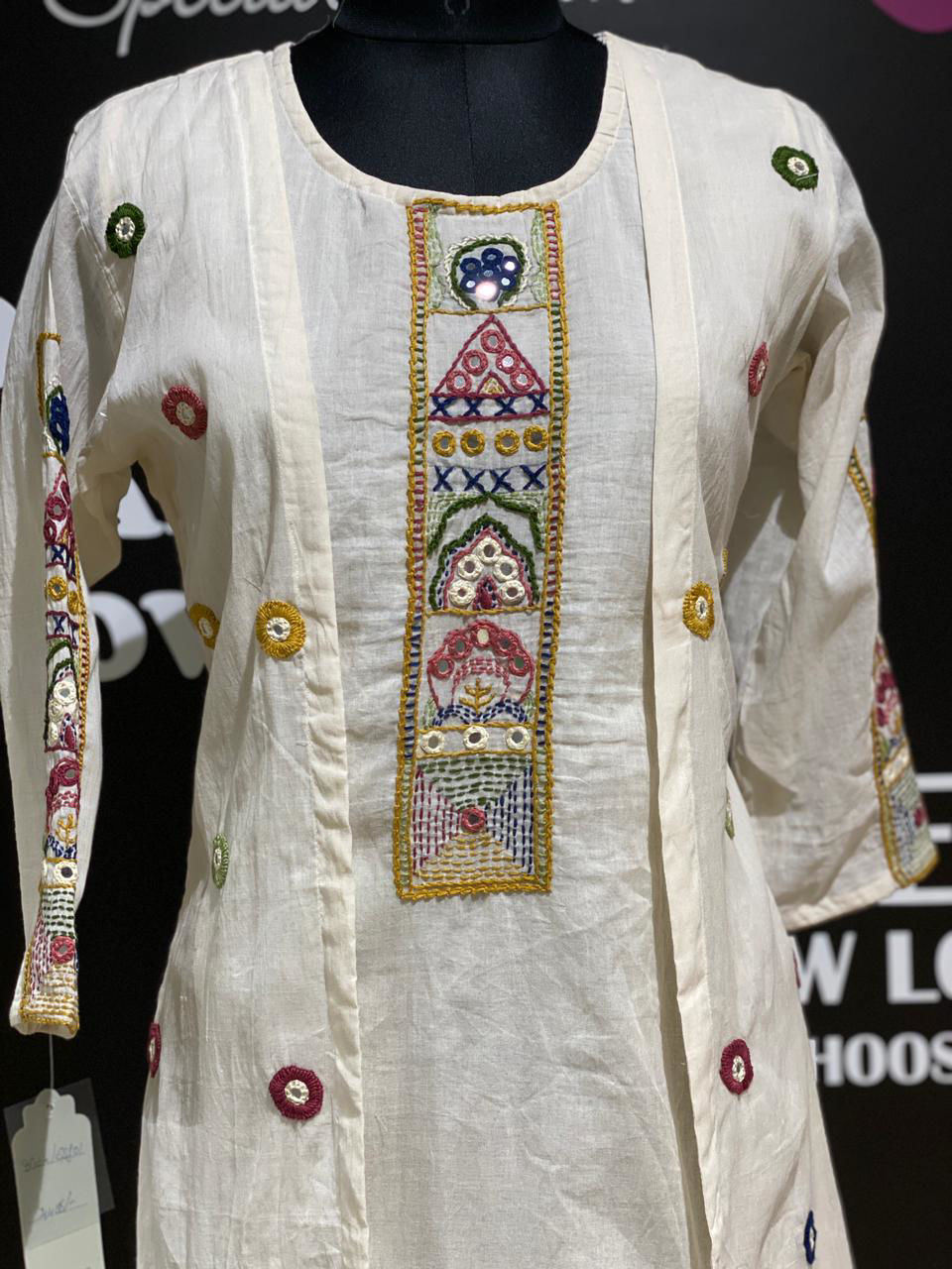 Picture of Smart linen based tunic with long work jacket and pants .. mirror work and embroidery done