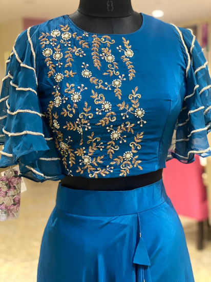 Picture of Crop top with hand work and bell slvs .. moti work done on sleeves .. crepe plain solid skirt with ruffles and tassels