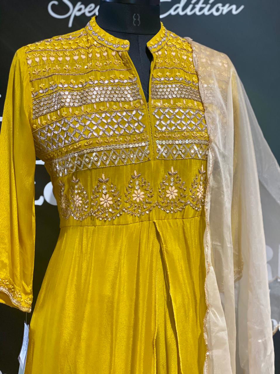 Picture of Long silk floor length gown with intricate hand done zardozi work yolk and organza silk Buti work dupatta
