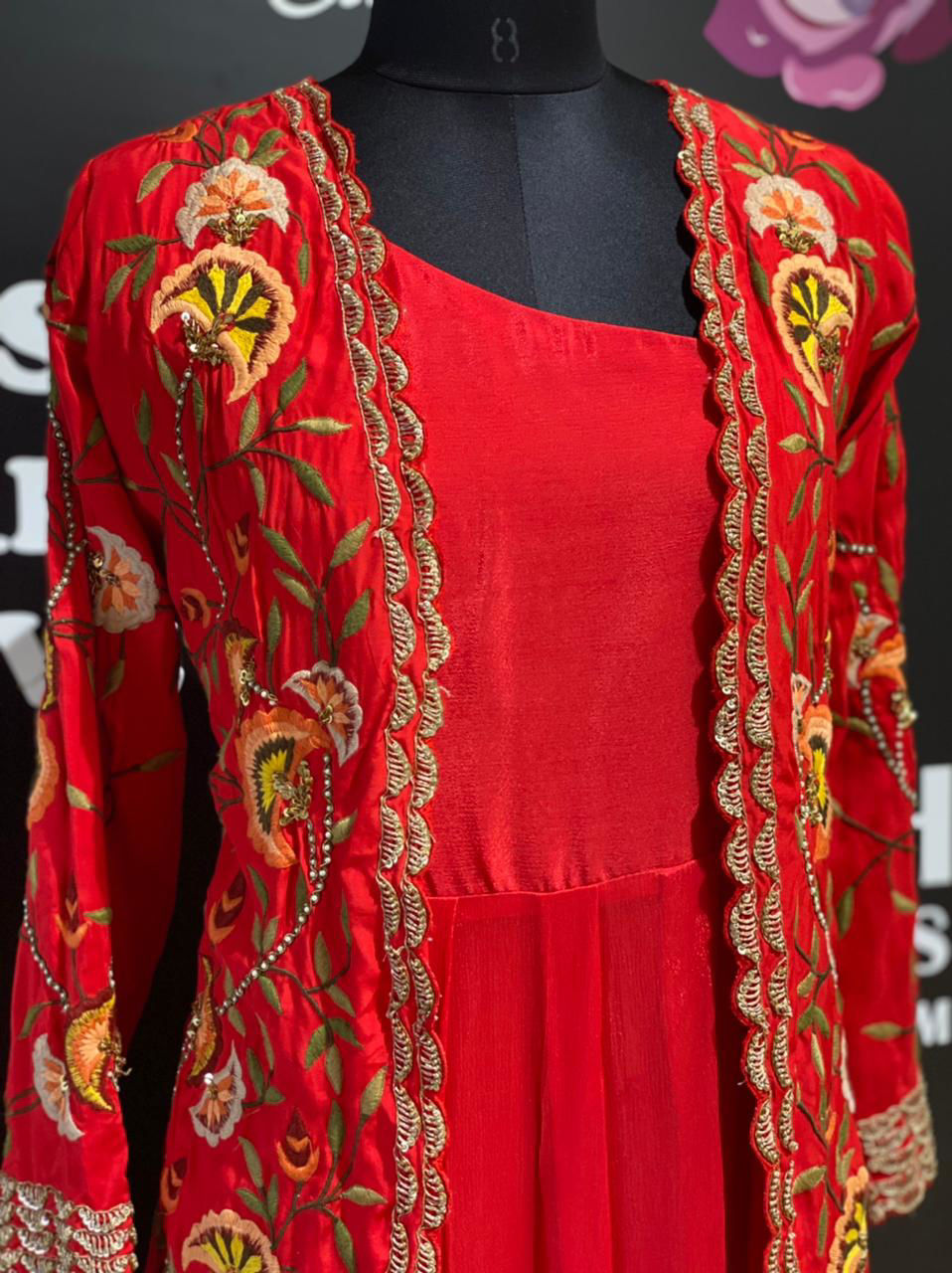 Picture of Long floor length gown in pure crepe silk with one side spegetti strap and mid length jacket with total hand work
