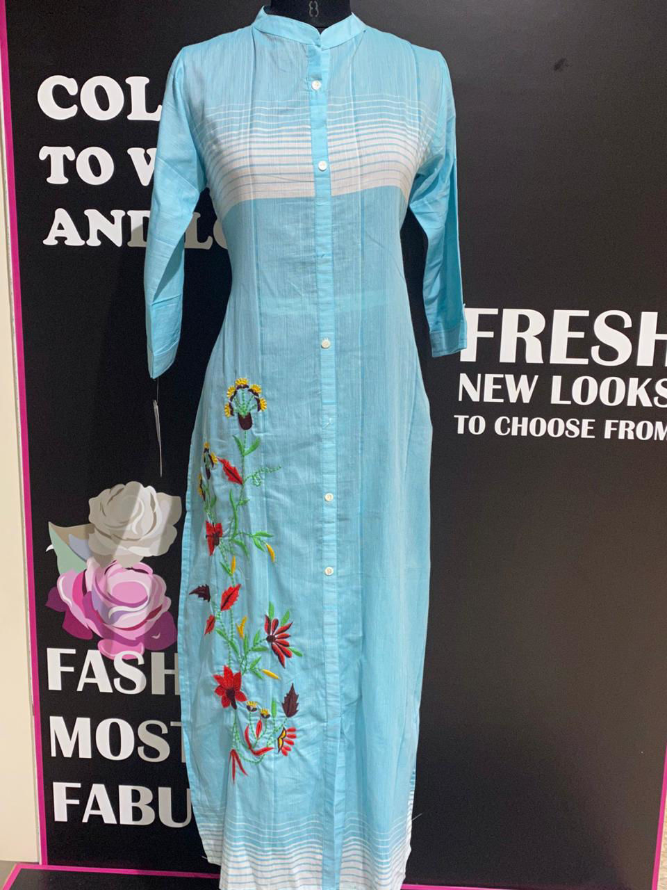 Picture of Straight cut long tunic in pure soft mal fabric with thread embroidery and button panelling