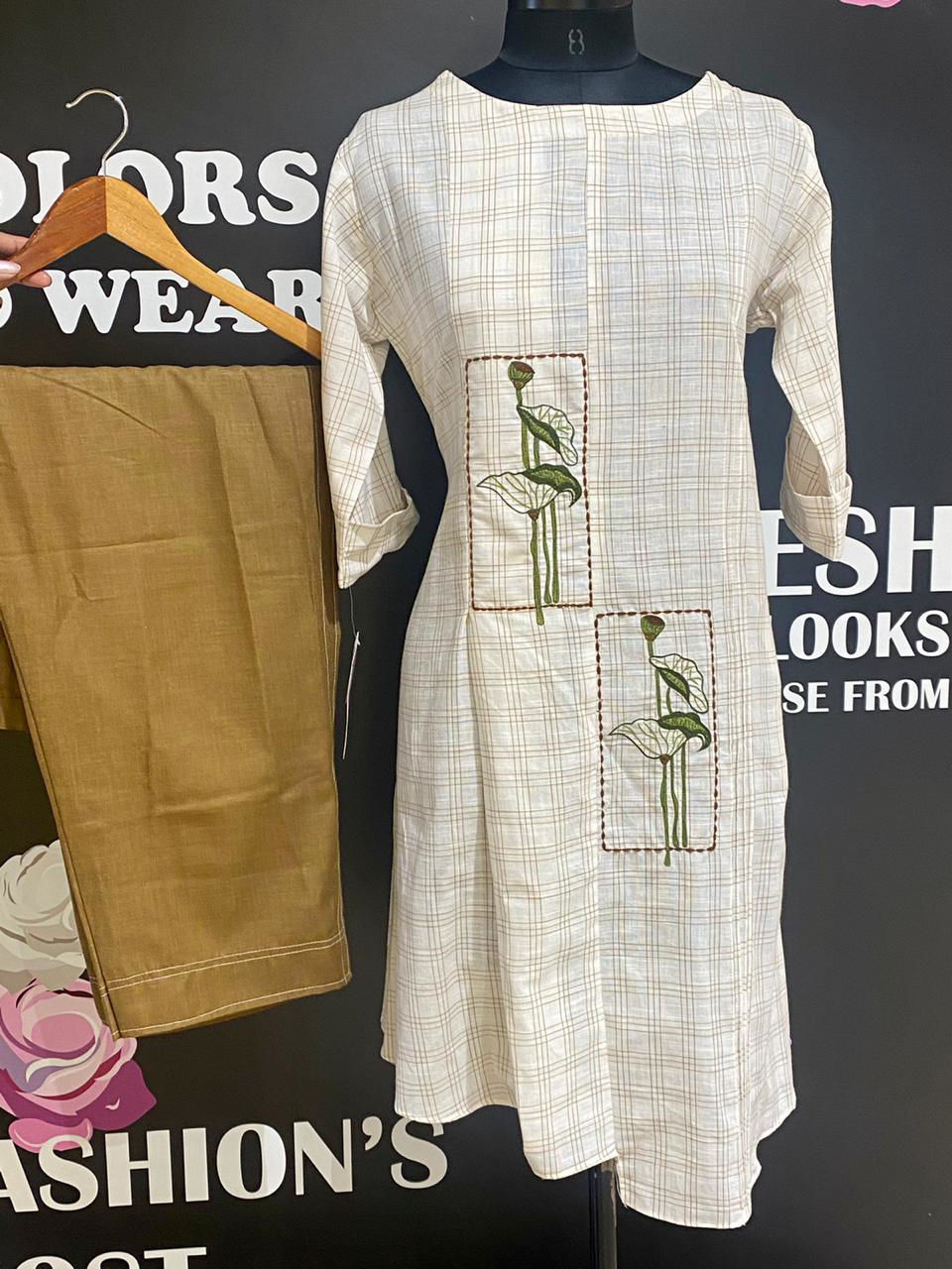 Picture of Short knee length kurta in checks with A symmetrical cut tunic with light brown pants