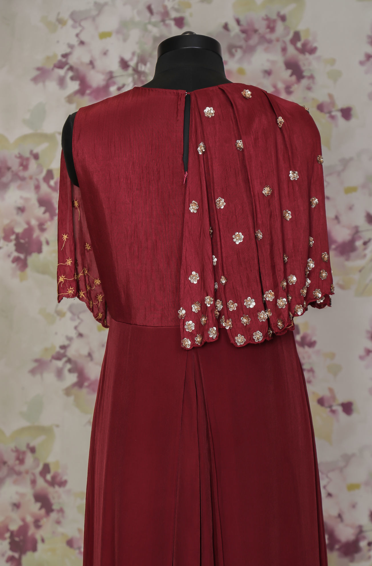 Picture of Crepe gown with attached poncho